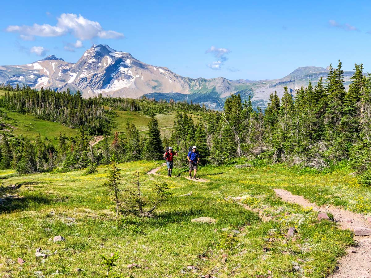 Two backpackers near Swiftcurrent pass on North Circle Backpacking Trail in Glacier National Park