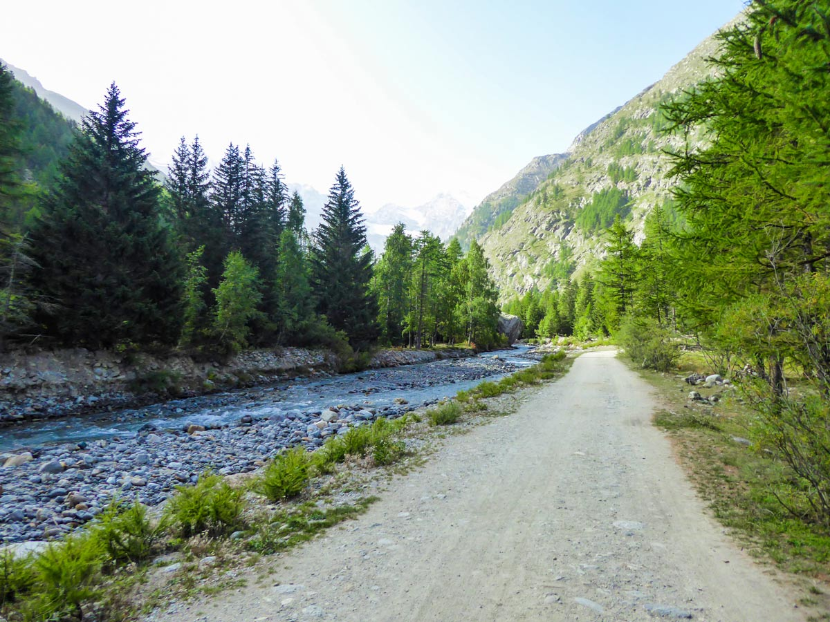 Wide path along Valnontey River on Alpe Money hike in Gran Paradiso National Park, Italy