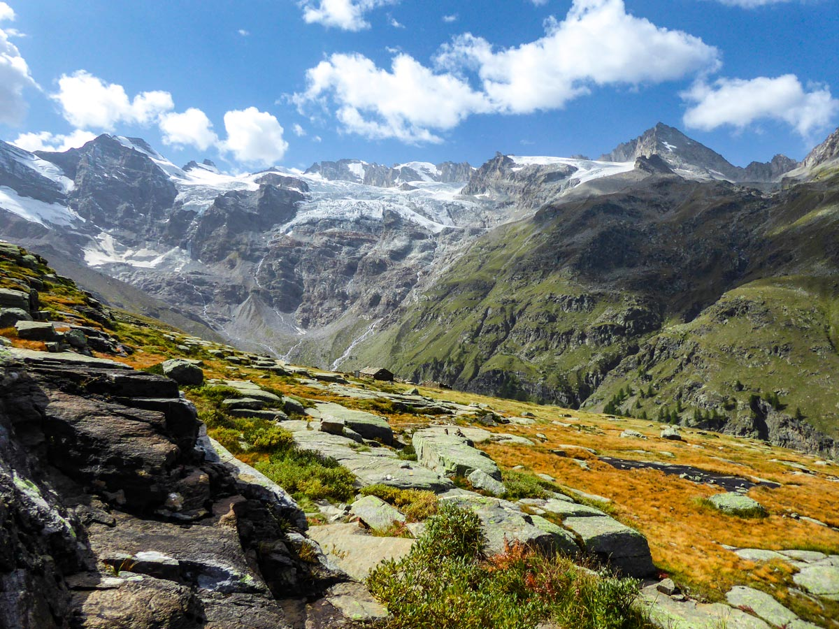 Alpe Money under beautiful glaciers on Alpe Money hike in Gran Paradiso National Park, Italy