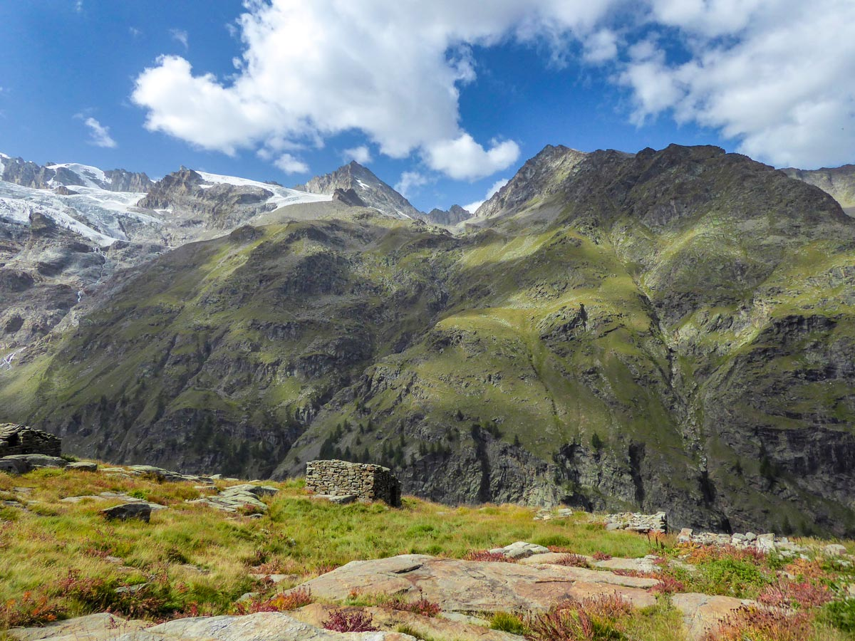 Ruin surrounded by peaks on Alpe Money hike in Gran Paradiso National Park, Italy