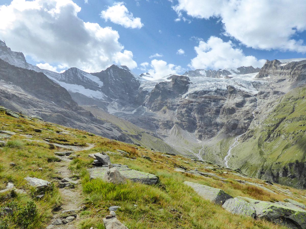 Slowly approaching beautiful Tribolazione Glacier on Alpe Money hike in Gran Paradiso National Park, Italy