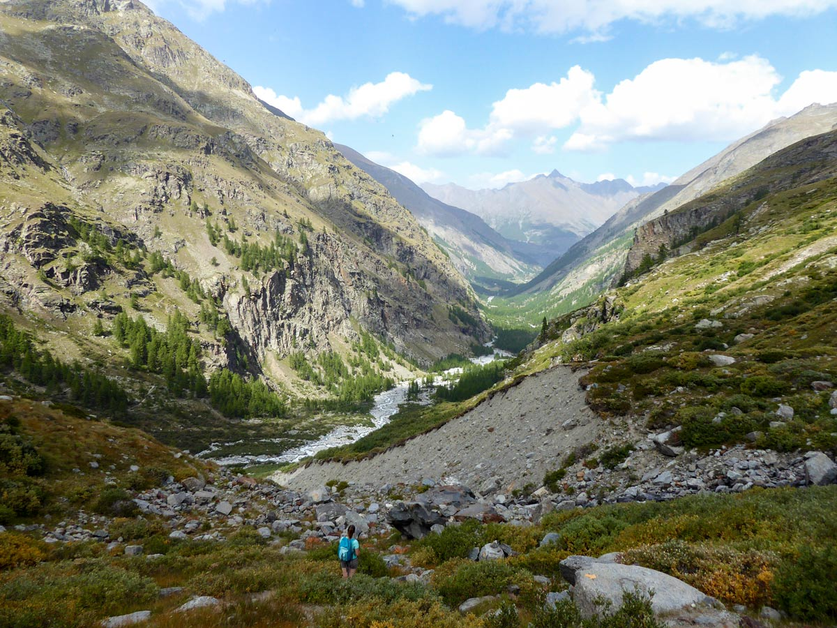 Looking at Valnontey Valley on Alpe Money hike in Gran Paradiso National Park, Italy