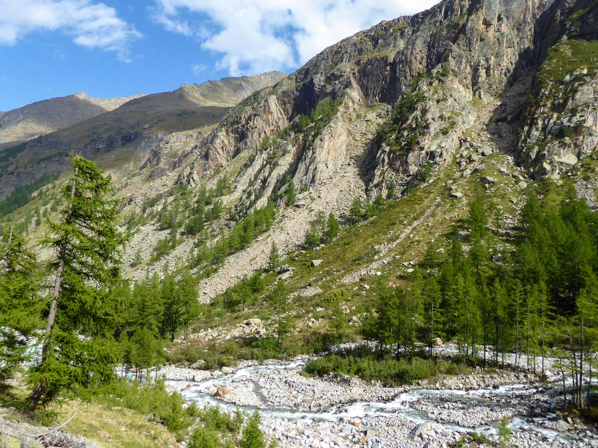 Rocky slopes along the trail on Alpe Money hike in Gran Paradiso National Park, Italy