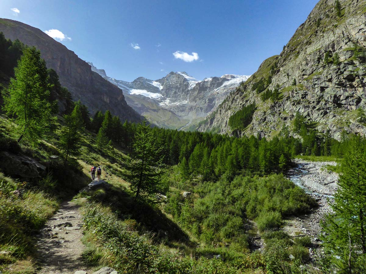 Approacing the snowy mountains on Alpe Money hike in Gran Paradiso National Park, Italy