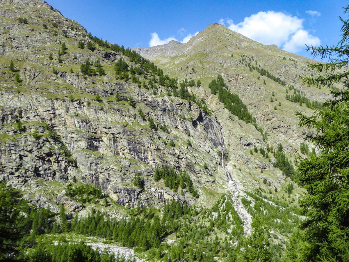 Lone small waterfall on Alpe Money hike in Gran Paradiso National Park, Italy