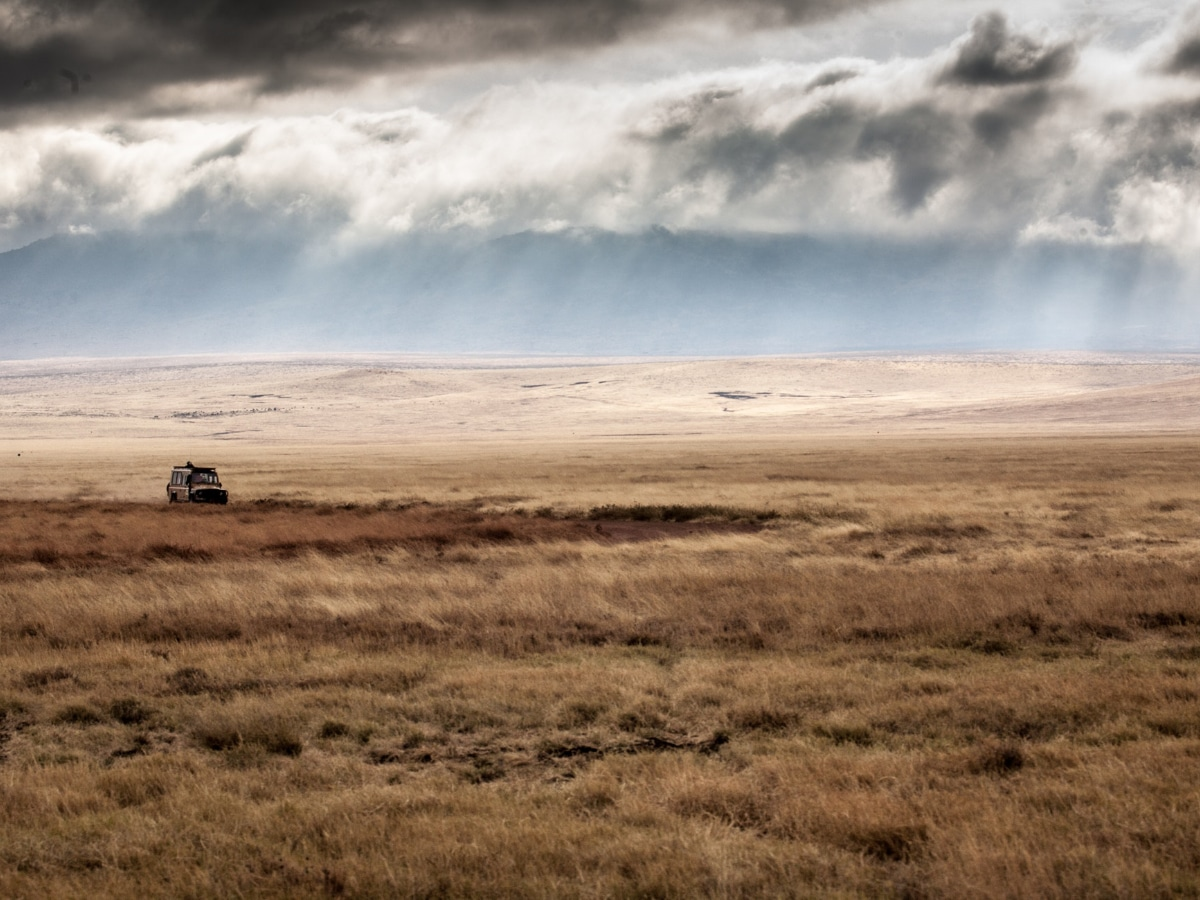 Views of a Ngorongoro Crater safari Jeep on this guided bike tour