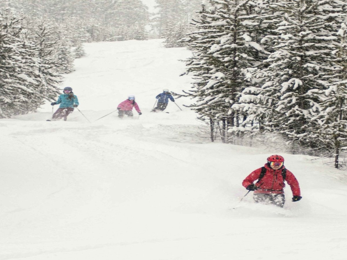 Skiing with friends downhill Photo Credit Panorama Mountain Resort