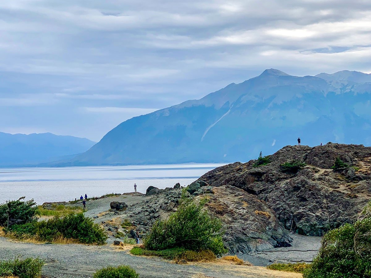 Tourists near Portage Lake near Byron Glacier Trail in Alaska