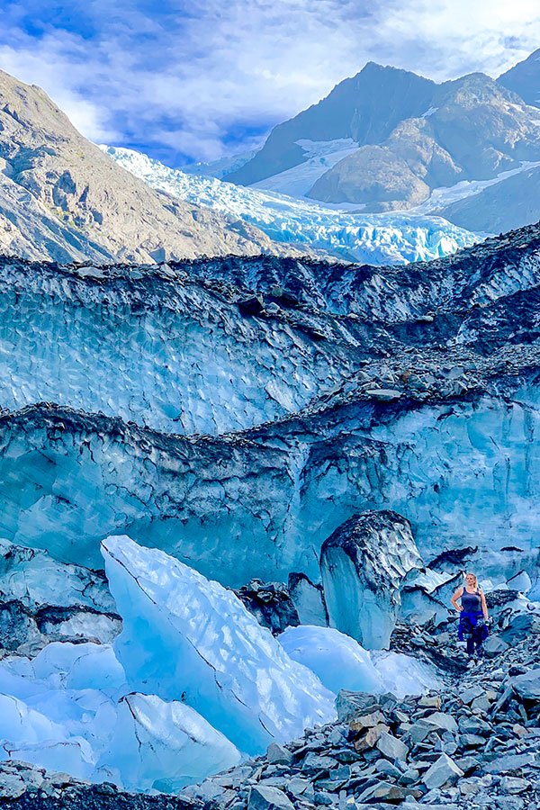 Hiker posing near Byron Glacier on a hike in Kenai Peninsula Alaska