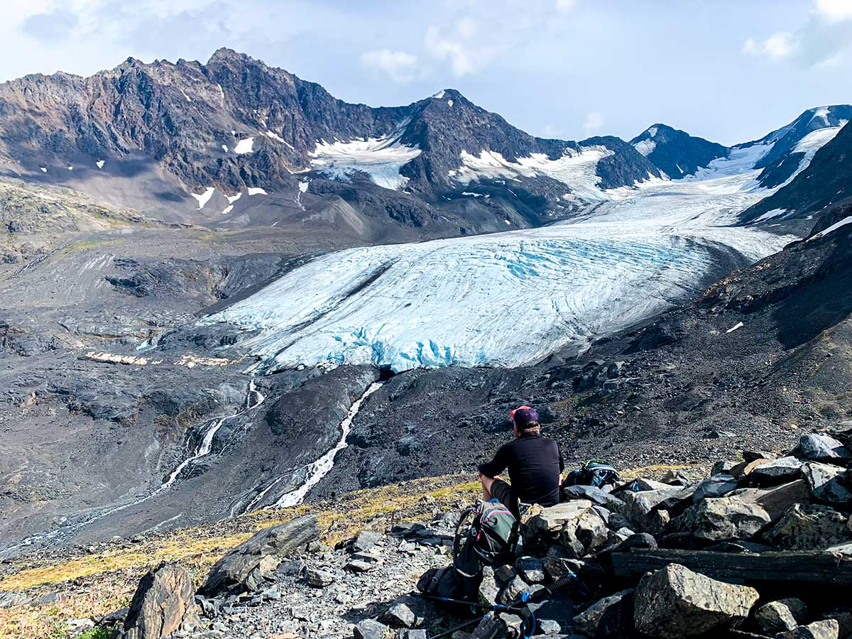 Hiker looking towards Raven Glacier on a Crow Pass Hike in Alaska