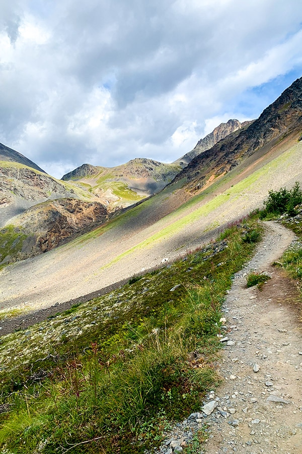 Colorful mountain path to Crow Pass and Raven Glacier overlook in Alaska