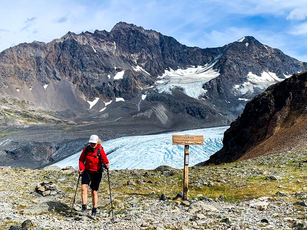 Hiker near Crow Pass with the view to Raven Glacier in Chugach State Park Alaska