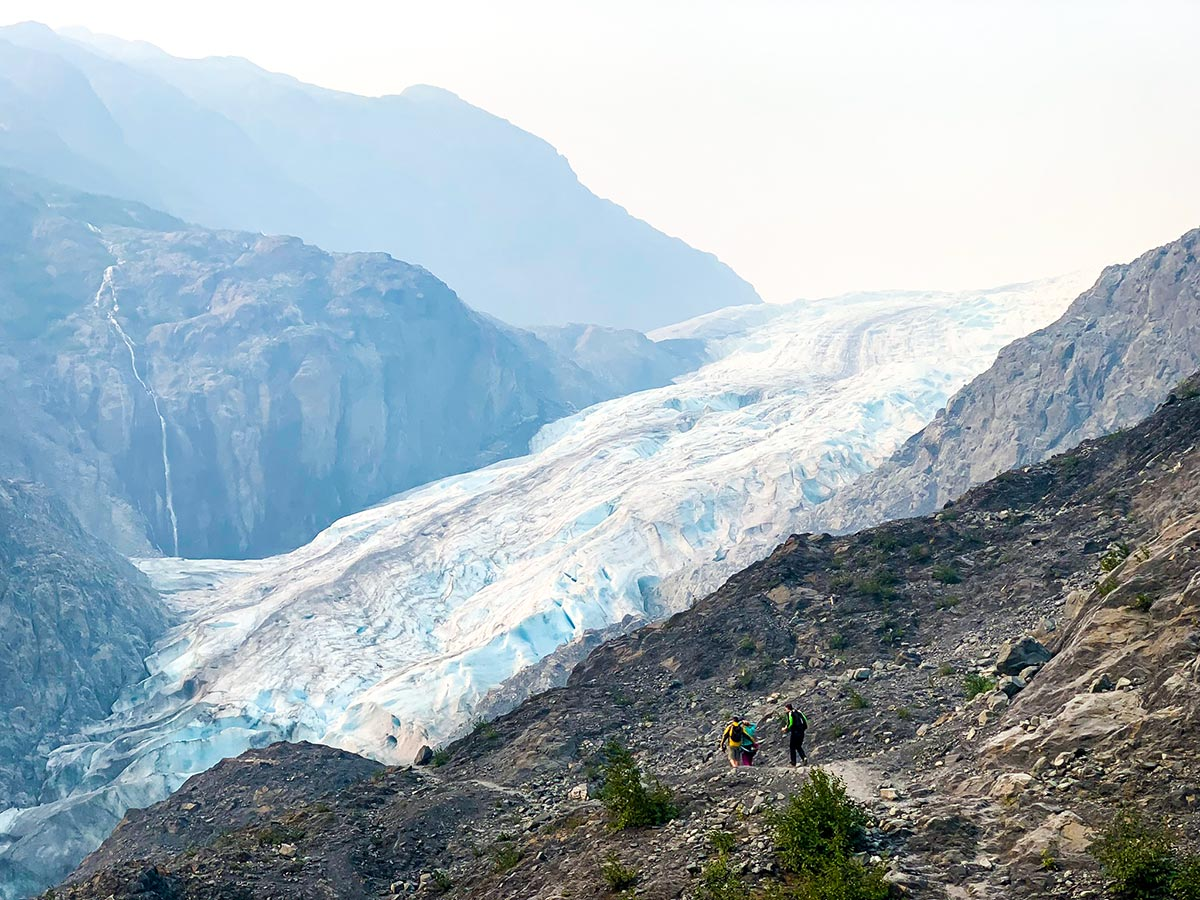 Group of hikers approaching Exit Glacier on a hike in Alaska