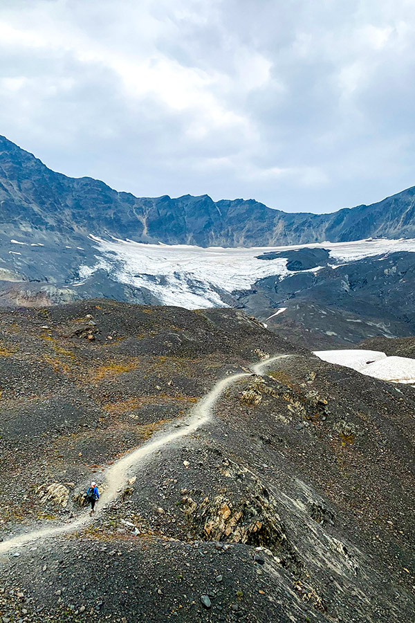Hikers on a trail to Harding Icefield in Alaska