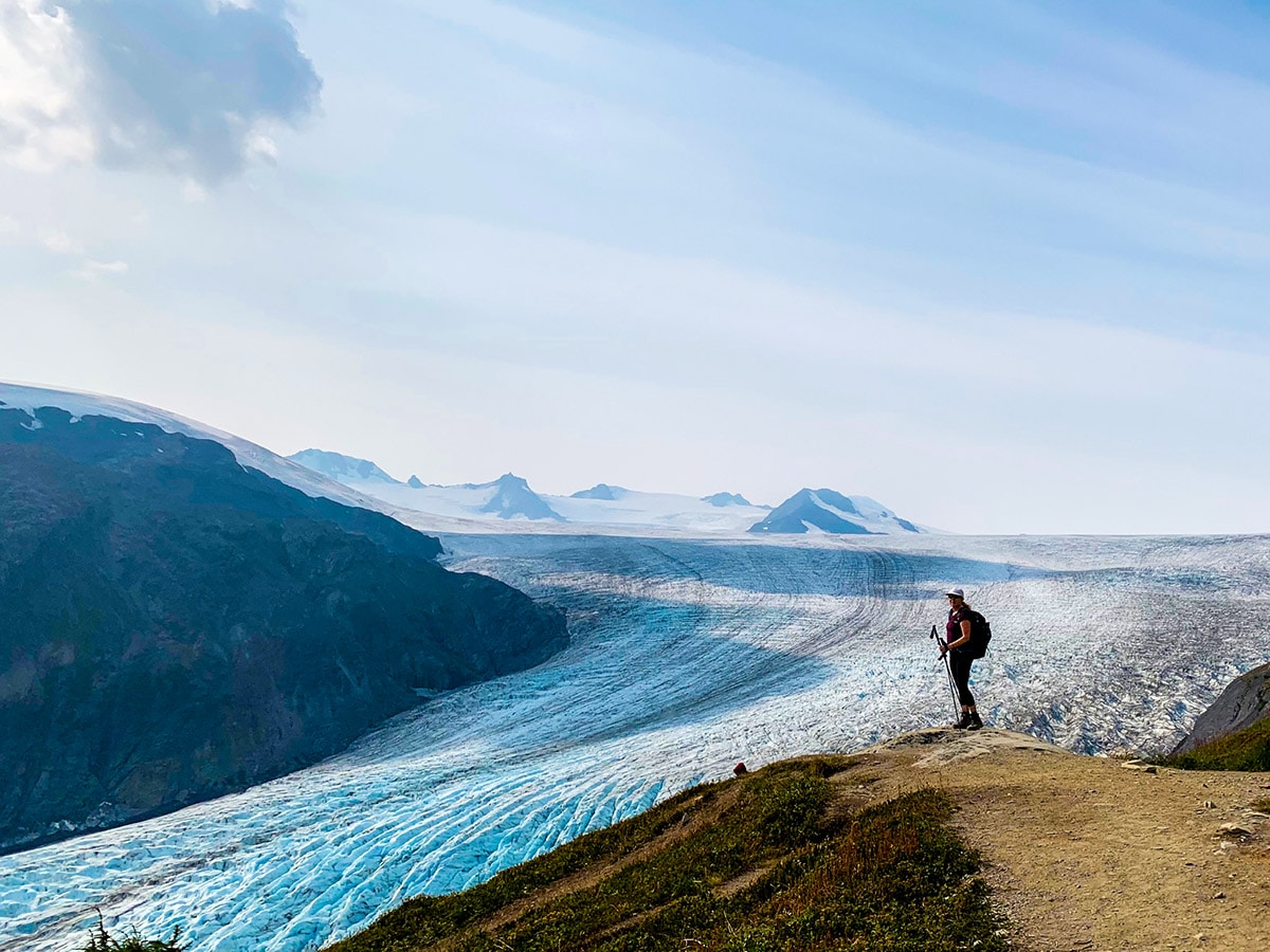 Hiker near overlook to the top of Exit Glacier on Harding Icefield Hike