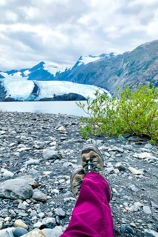 Resting in front of Portage Glacier on Portage Pass and Lake Trail Alaska