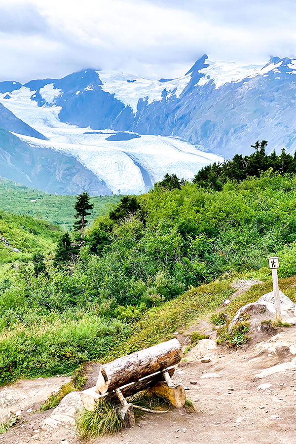 Bench with beautiful views of area surrounding Portage Lake on a hike in Alaska