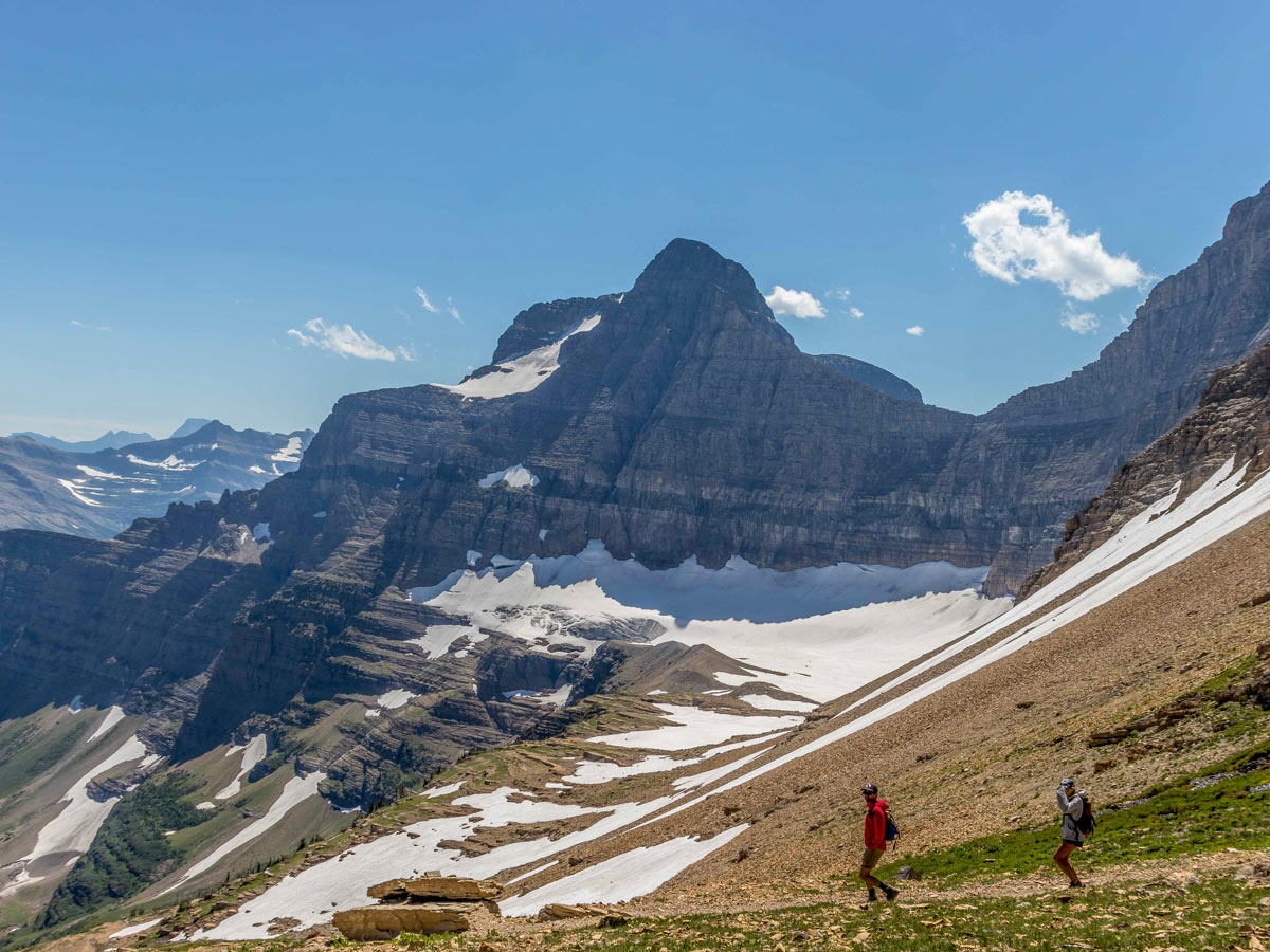 Two hikers on beautiful Siyeh Pass trail
