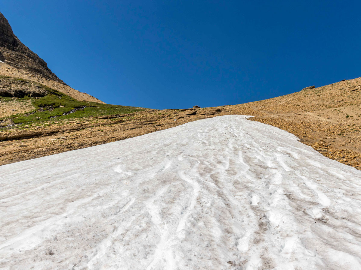 Looking up at remains of a glacier on Siyeh Pass