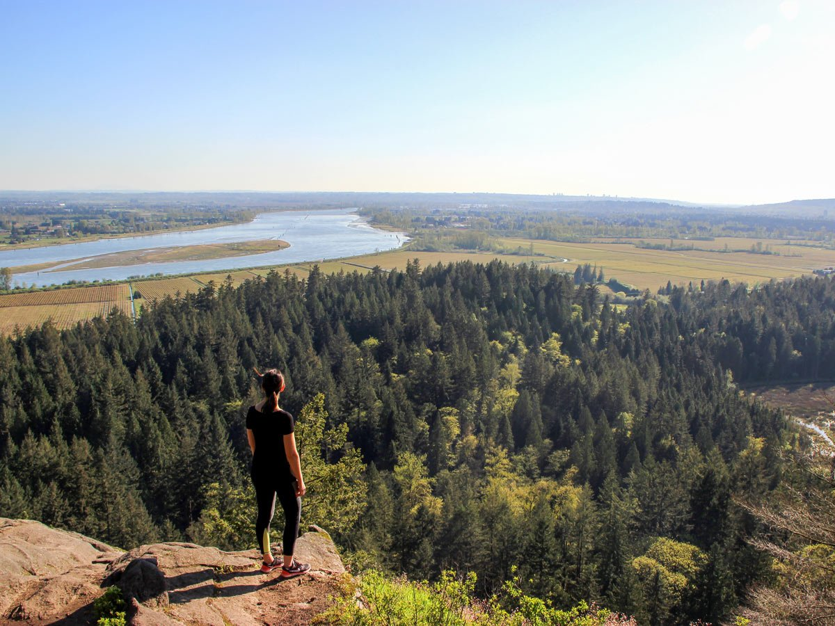 Hiker admires view from High Knoll lookoutnear Vancouver