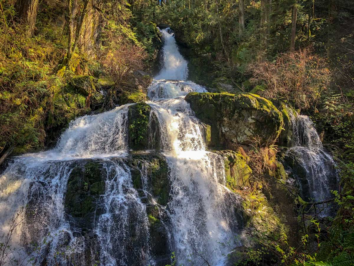 Sunny Steelhead Falls waterfalls east of Vancouver on forest hiking trail