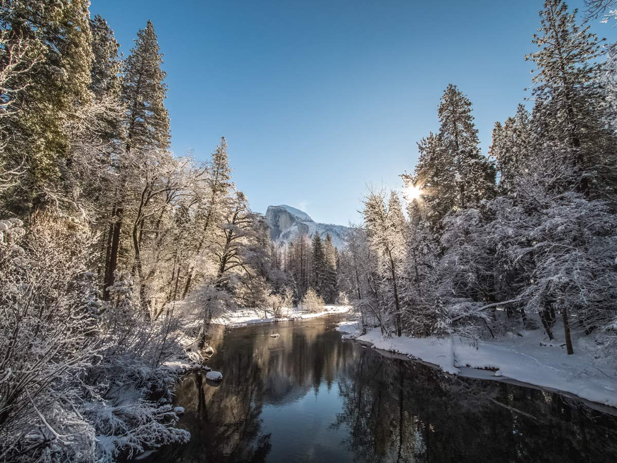 Beautiful sunny winter day snow and river in Yosemite National Park USA