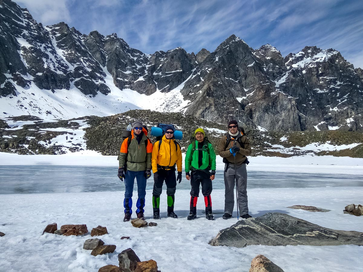 Four backpackers during the winter