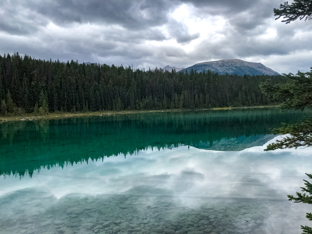 Beautiful water reflections hiking Valley of the Five Lakes Jasper Alberta Canada