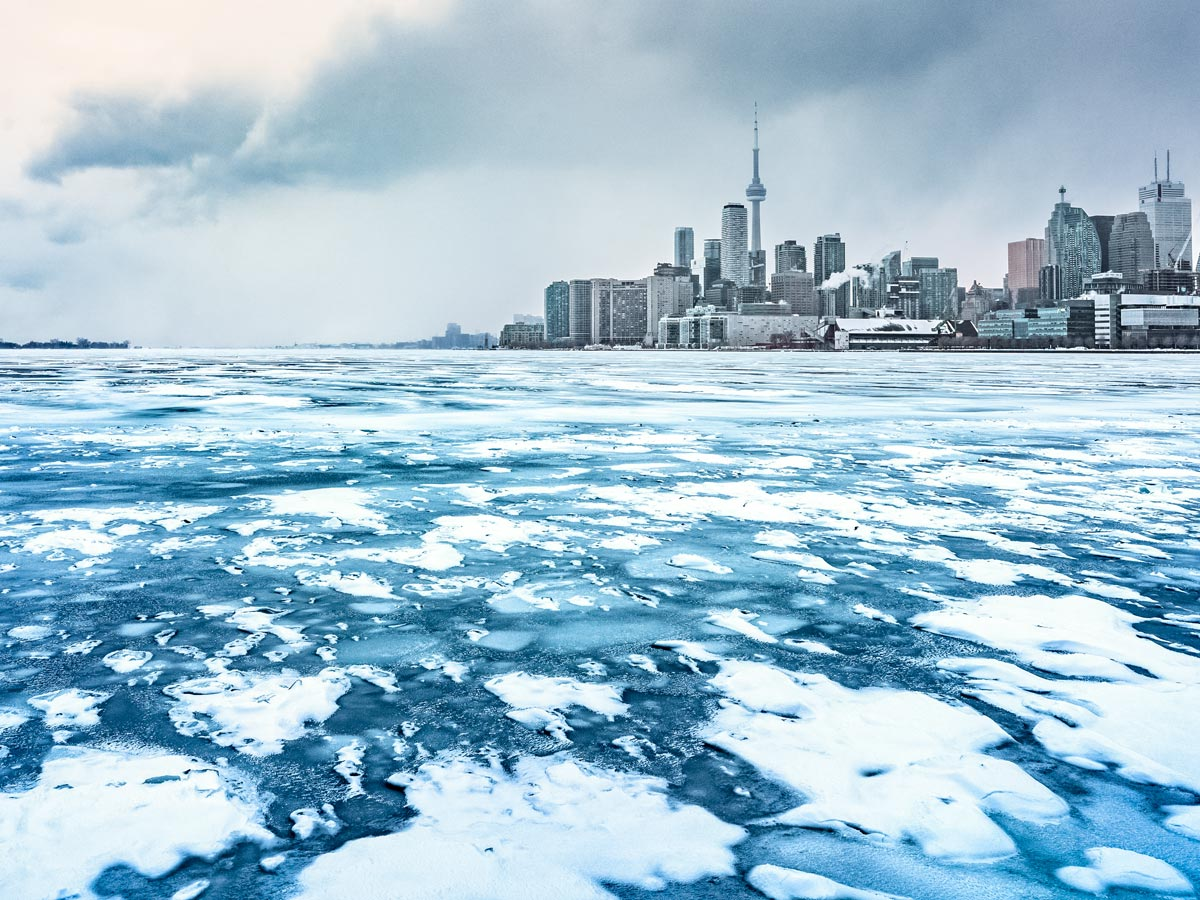 Frozen water surrounding downtown Toronto in winter