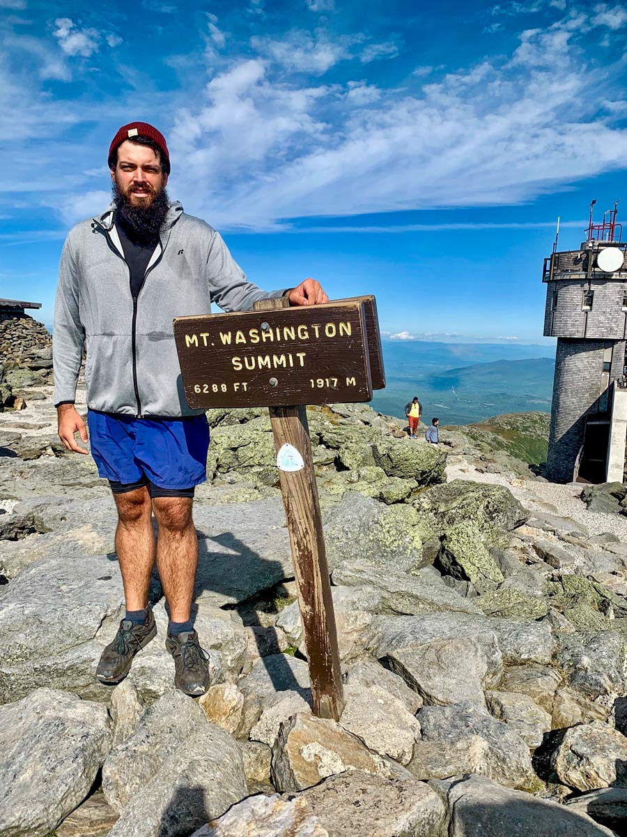 A rare clear day on Mt. Washington, hiding my disdain for the line of people who drove to the top wanting to take a picture with the sign.