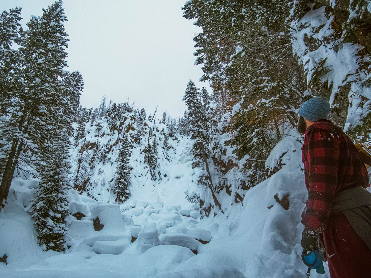 Winter hiking in the snow to frozen waterfalls pillows nears Denver Colorado