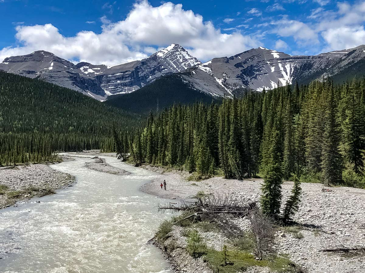 Hikers exploring by the river Little Elbow hiking trail Kananaskis Alberta Canada