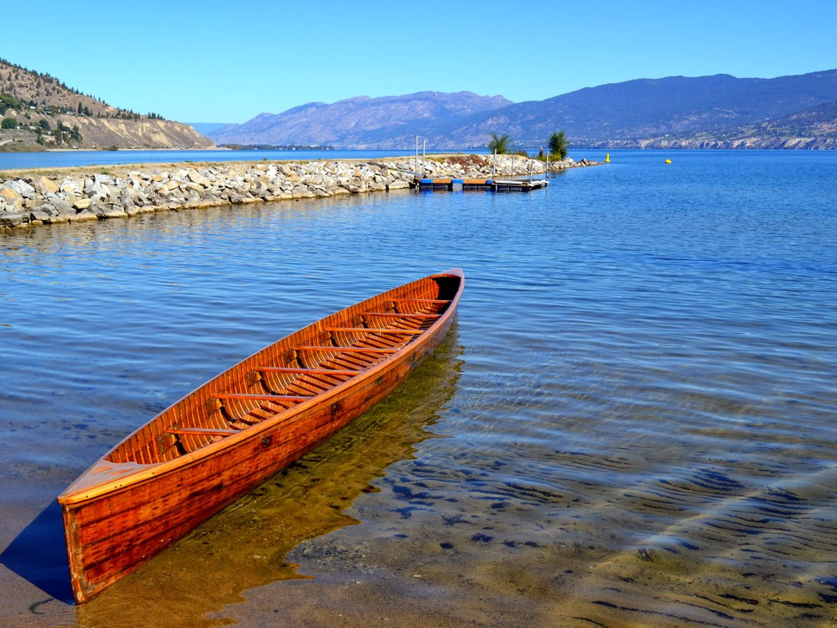 Okanagan lake old wooden canoe on the shore Kelowna British Columbia Canada