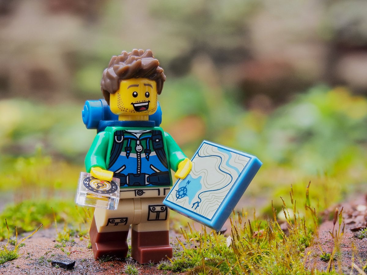 Lego hiker prepared with map and compass