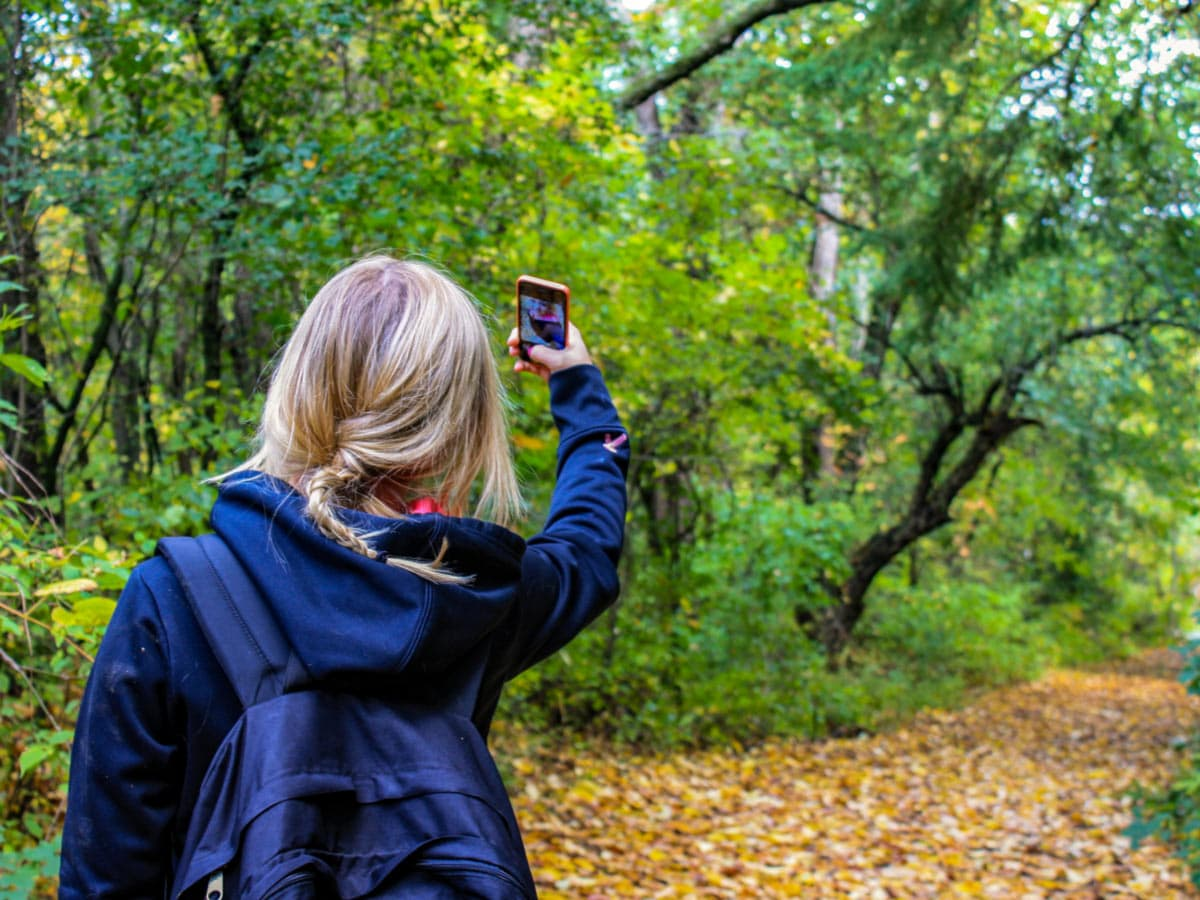 Hiker taking a selfie in the forest