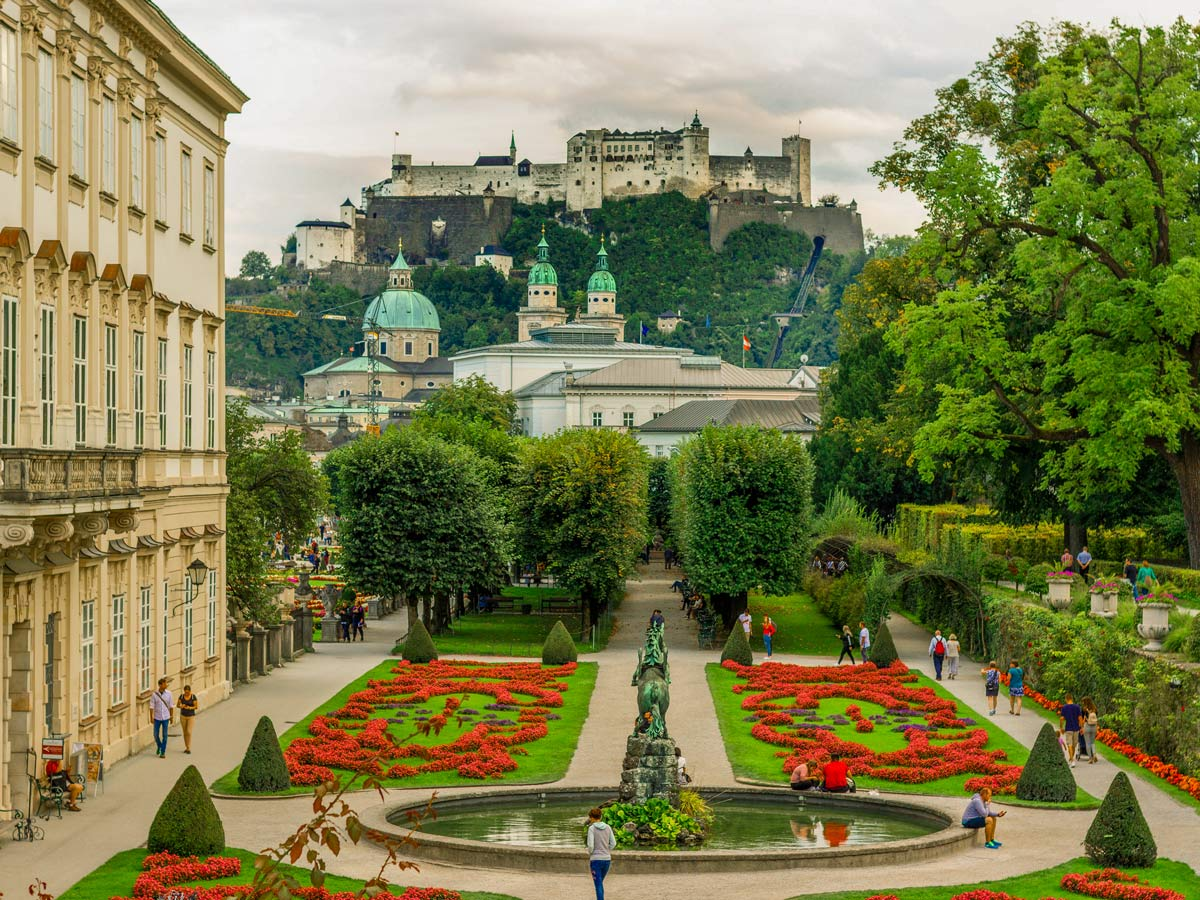 Fortress Hohensalzburg perched high on the hill above Mirabell Palace and gardens