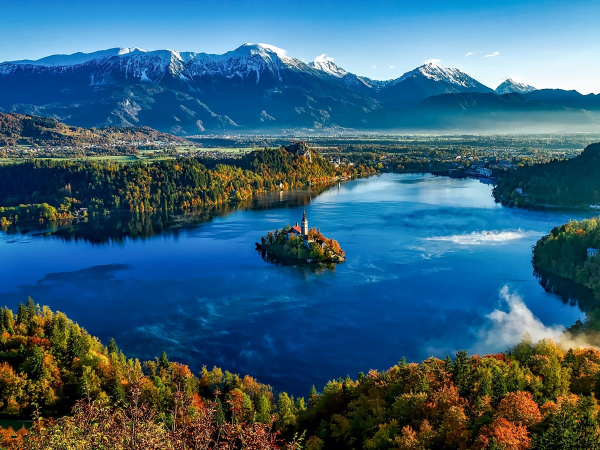 Lake Bled church on the Island Slovenia Fall forest and mountains