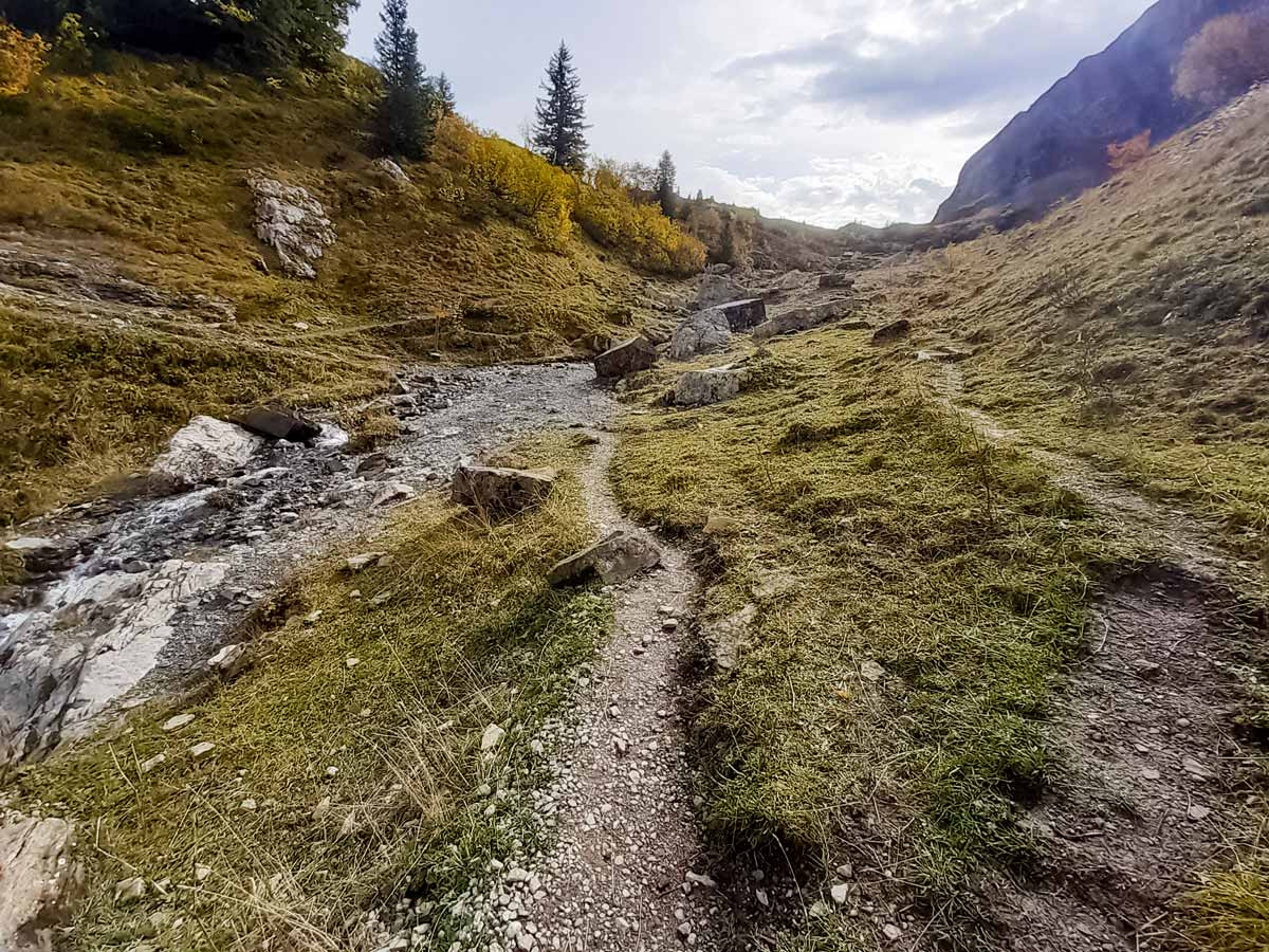 Rocky path leading to valley Col Des Aravis hiking trails in France