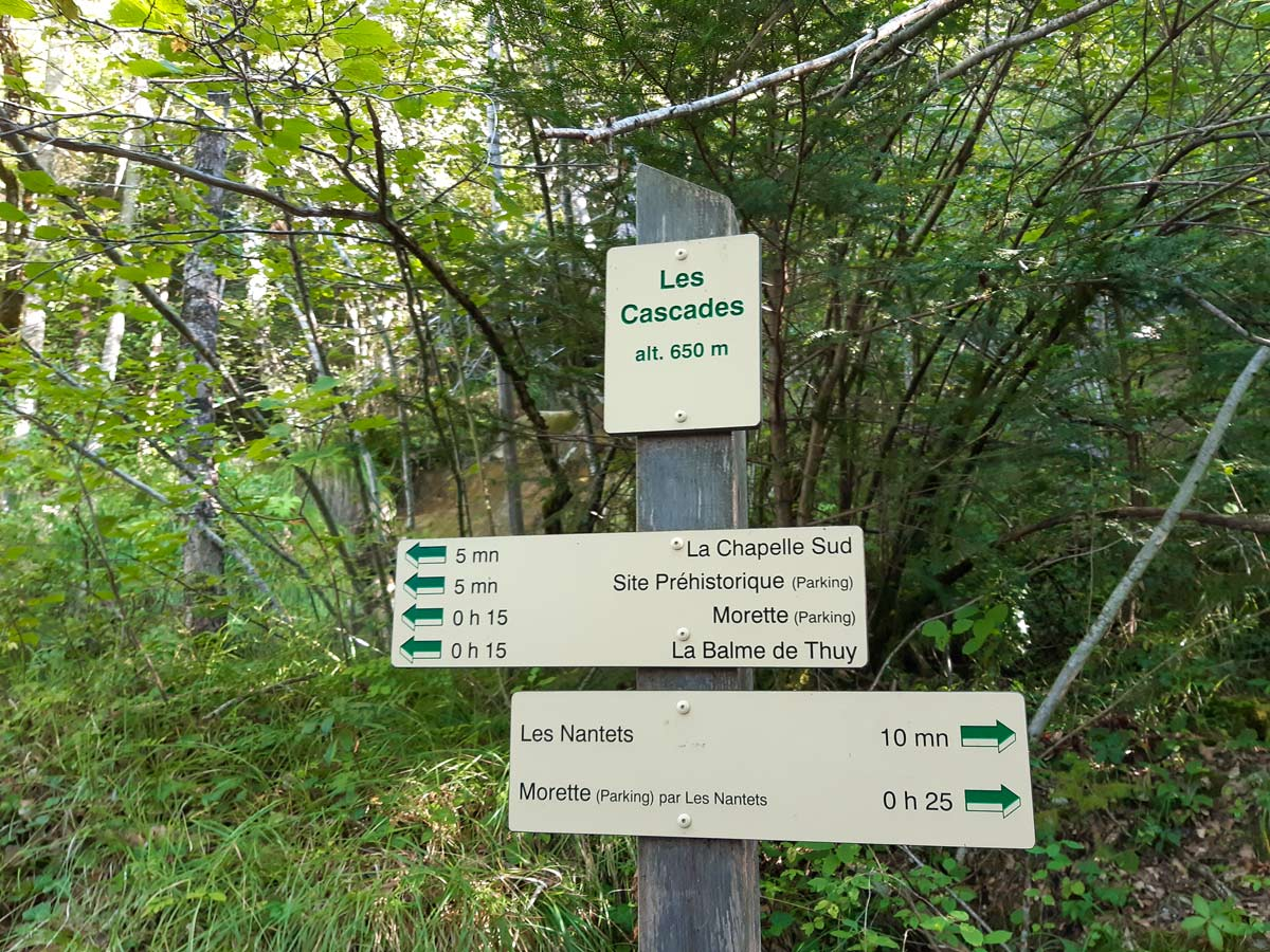 Signpost at waterfall hiking Morette Falls trail France