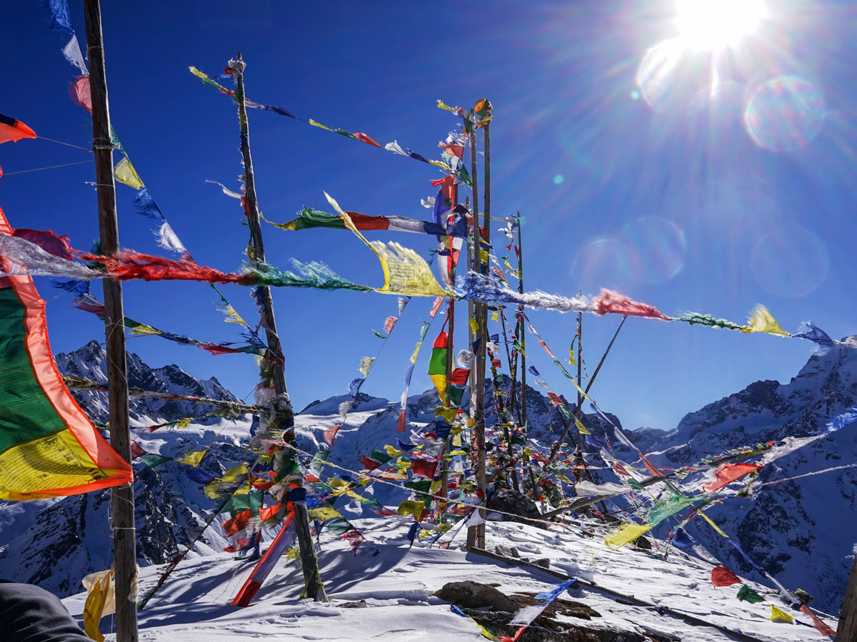 Colourful flags at the summit