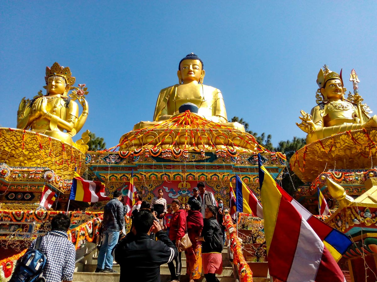 Giant Buddha and god statue monuments at temple in Kathmandu Nepal