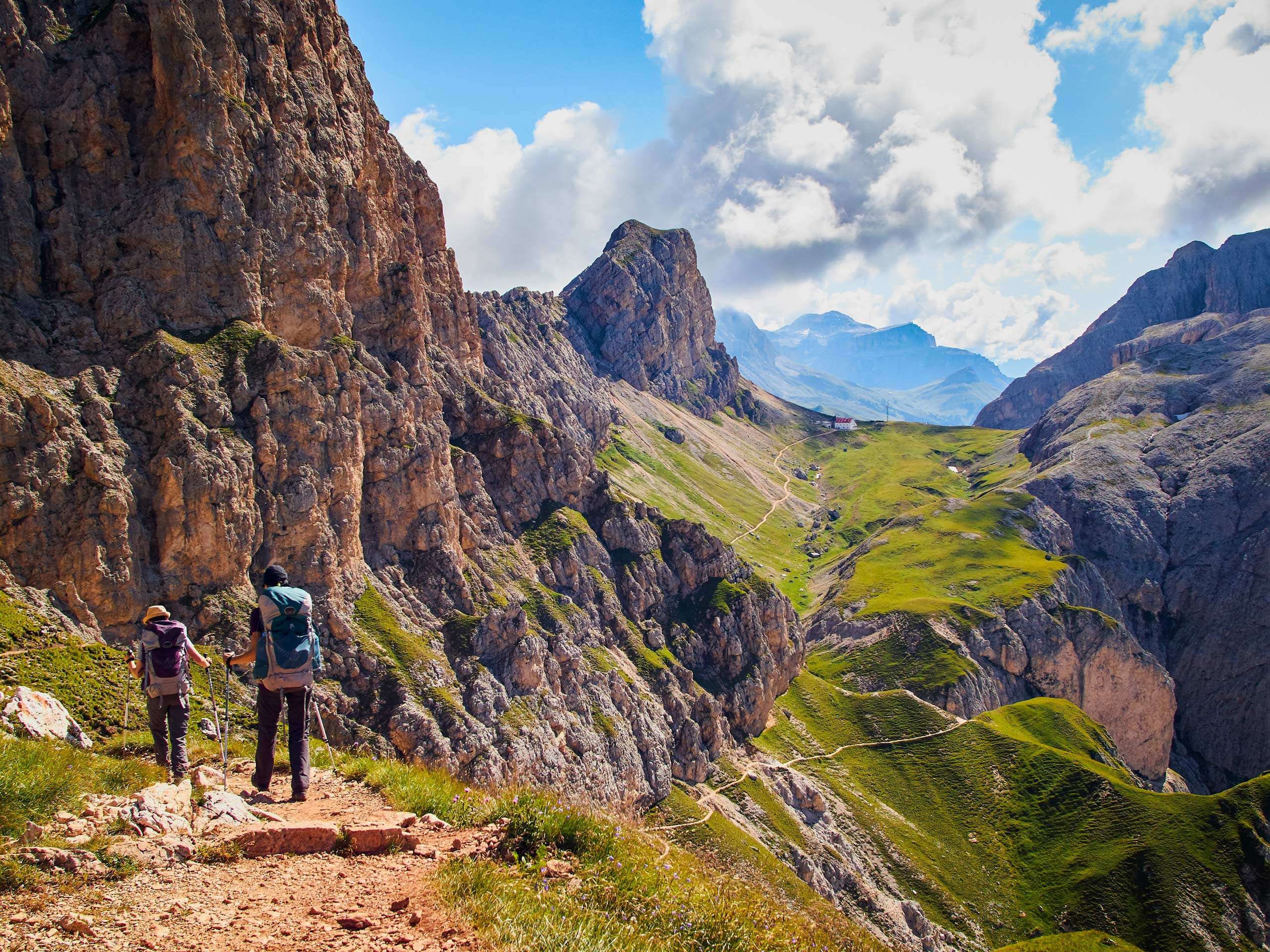Backpackers trekking through hills and canyons